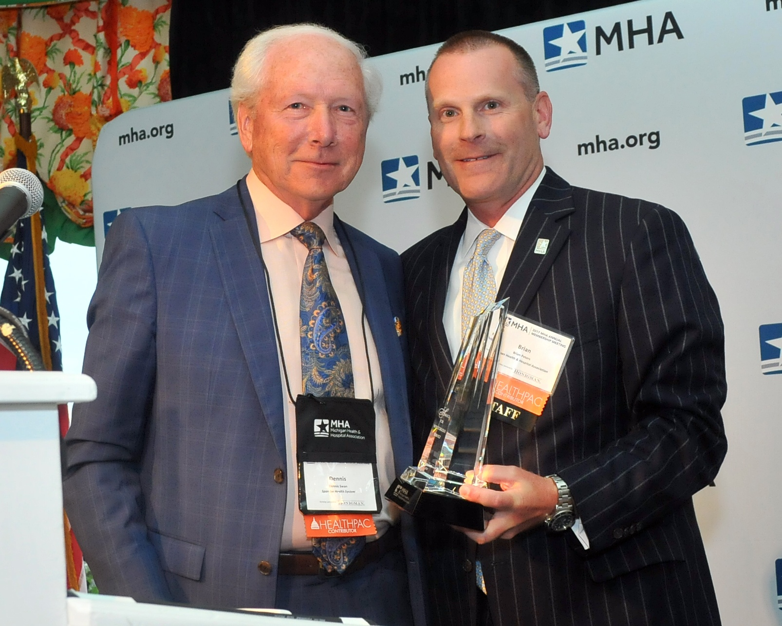 The photo feature Dennis with MHA CEO Brian Peters
