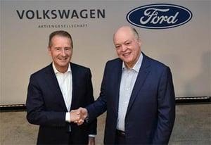 Dr. Herbert Diess, Ford President and CEO Jim Hackett