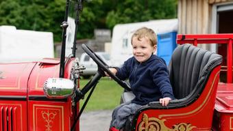 Happy-Child-In-Firetruck-e1451925644812