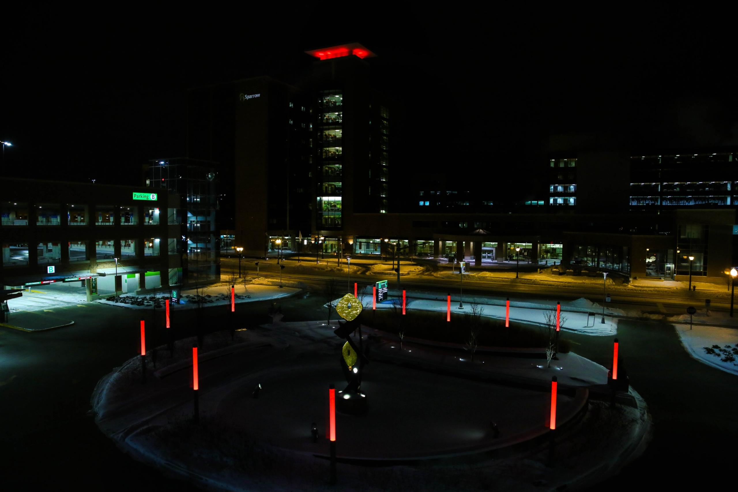 Photo of Sparrow Hospital and the Sparrow Herbert-Herman Cancer Center, Lansing, Michigan, lit red in commemoration of the month.