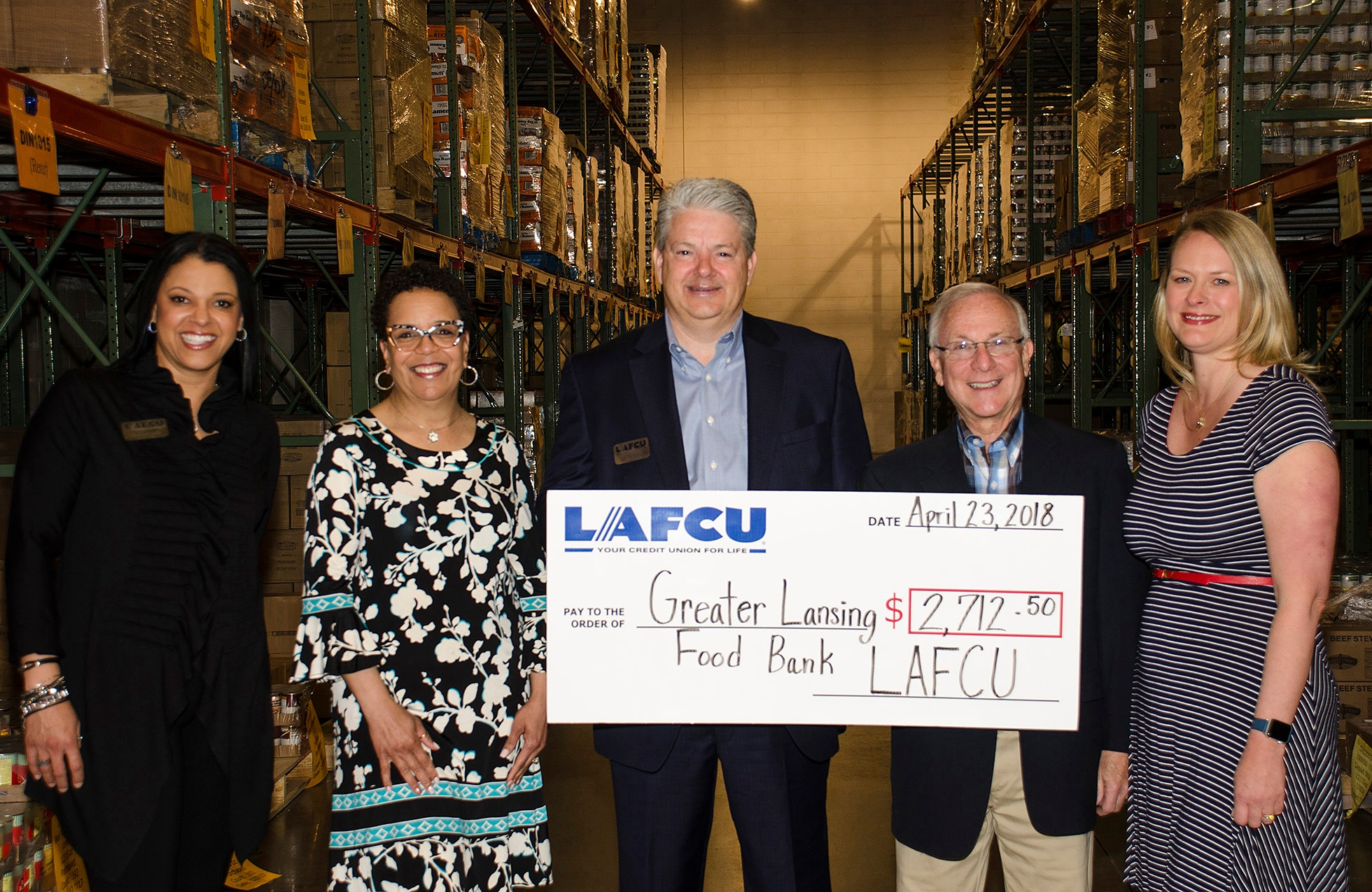 Present at the check presentation to Greater Lansing Food Bank are, from left, LAFCU's Shelley Davis Boyd, corporate marketing strategist, Kelli Ellsworth Etchison, chief marketing officer, and Patrick Spyke, CEO; Joe Wald, GLFB executive director; and Melissa Nay, WKAR TV/Radio director of corporate development.