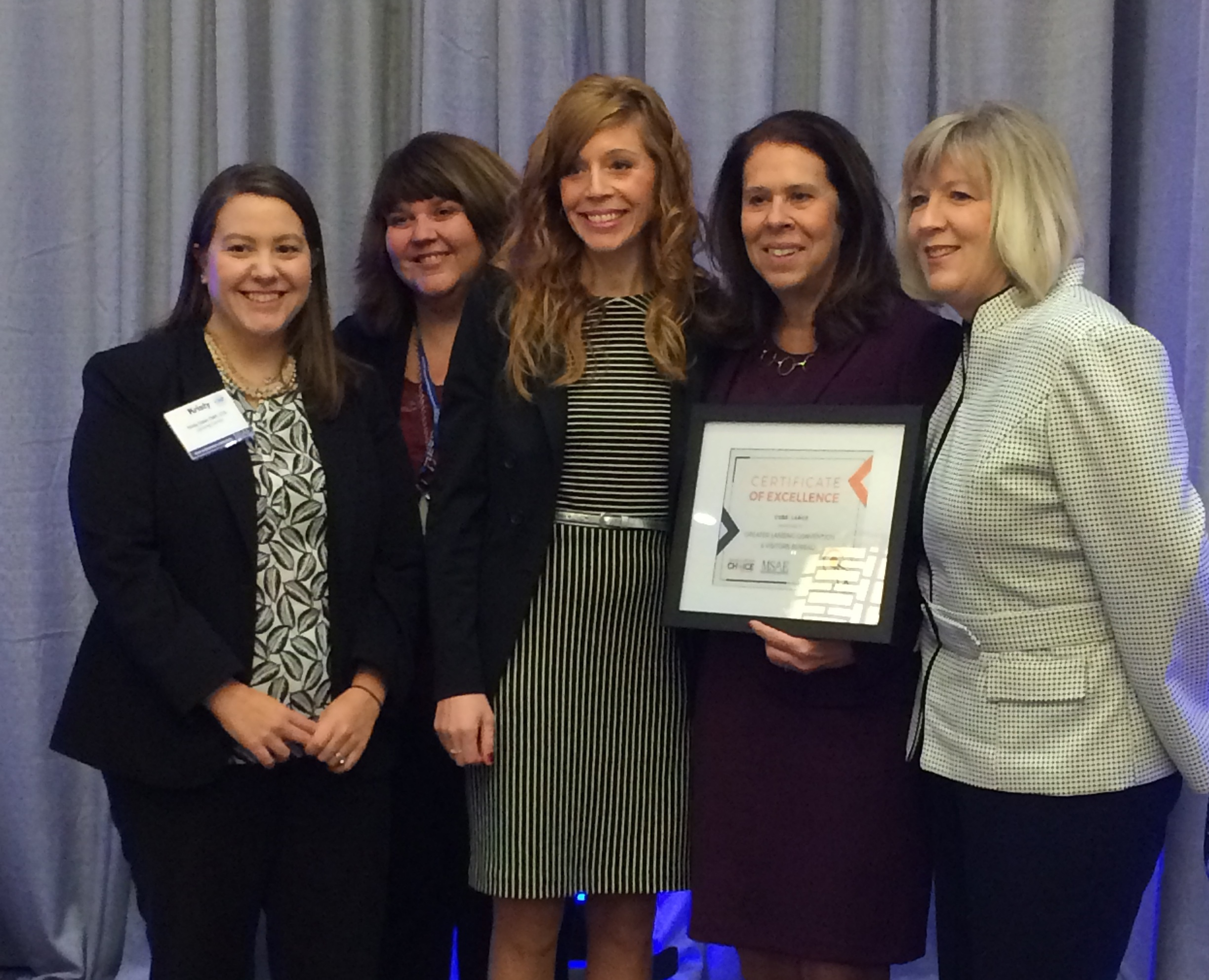 Staff of the Greater Lansing CVB join Cheryl Ronk, Executive Director of the MSAE, to receive an award for Best Large CVB, as voted by MSAE Members Left to right; Kristy Doak, Brenda Haight, Amanda Toy, Cheryl Ronk and Mary Chris Hotchkiss