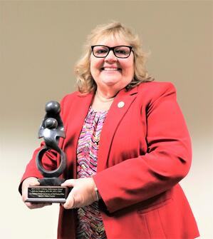 Beth Daugherty, BSN, RN, MPH, CRRN, Hospital Administrative Officer and Chief Nursing Officer, at Sparrow Clinton Hospital was presented with a DAISY Lifetime Achievement Award at a special ceremony on Dec. 12