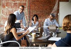 stock-photo-businesspeople-meeting-in-modern-boardroom-through-glass-547750285.jpg