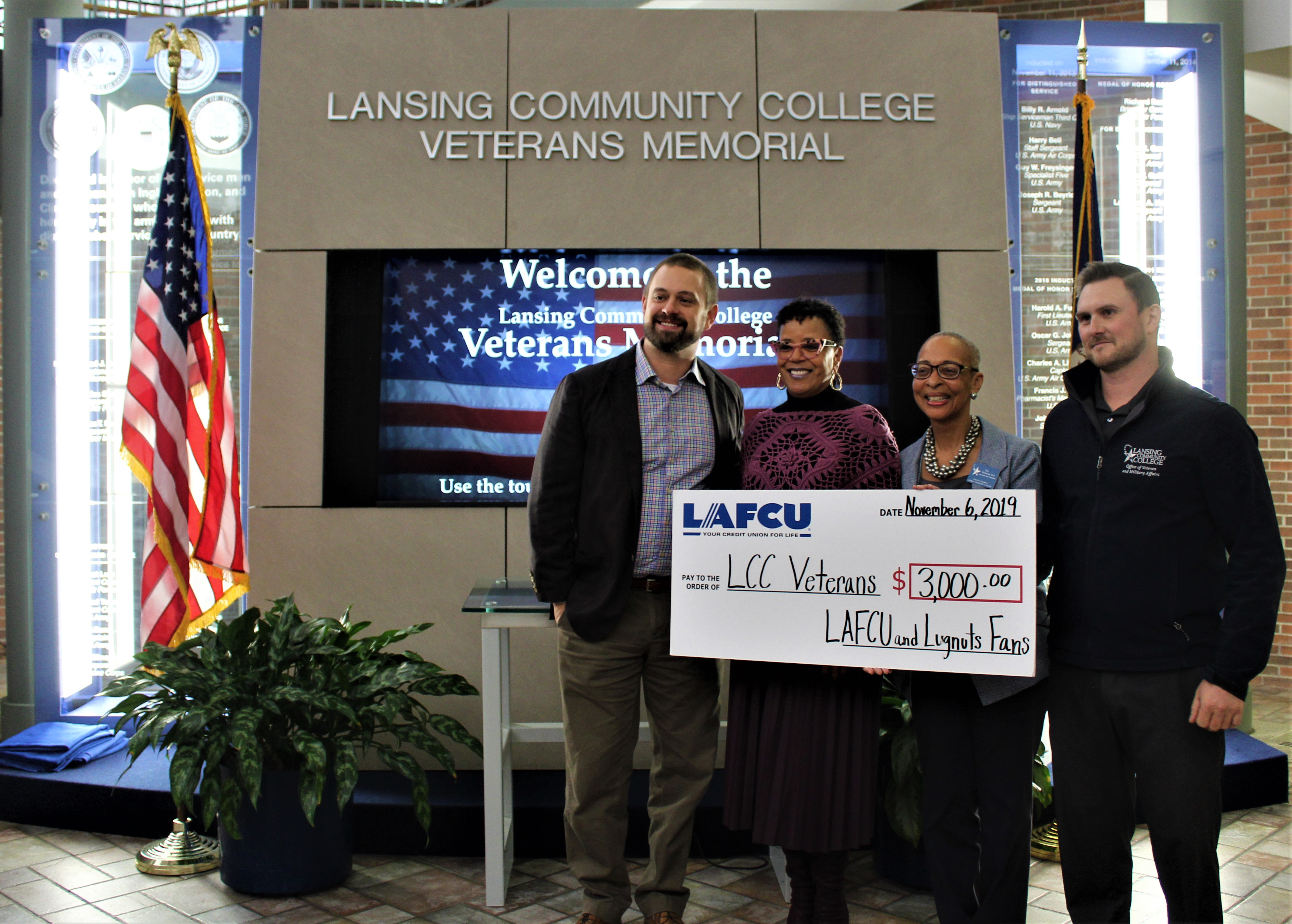 Nick Grueser (far left) with LAFCU, and LCC staff at a recent check presentation.