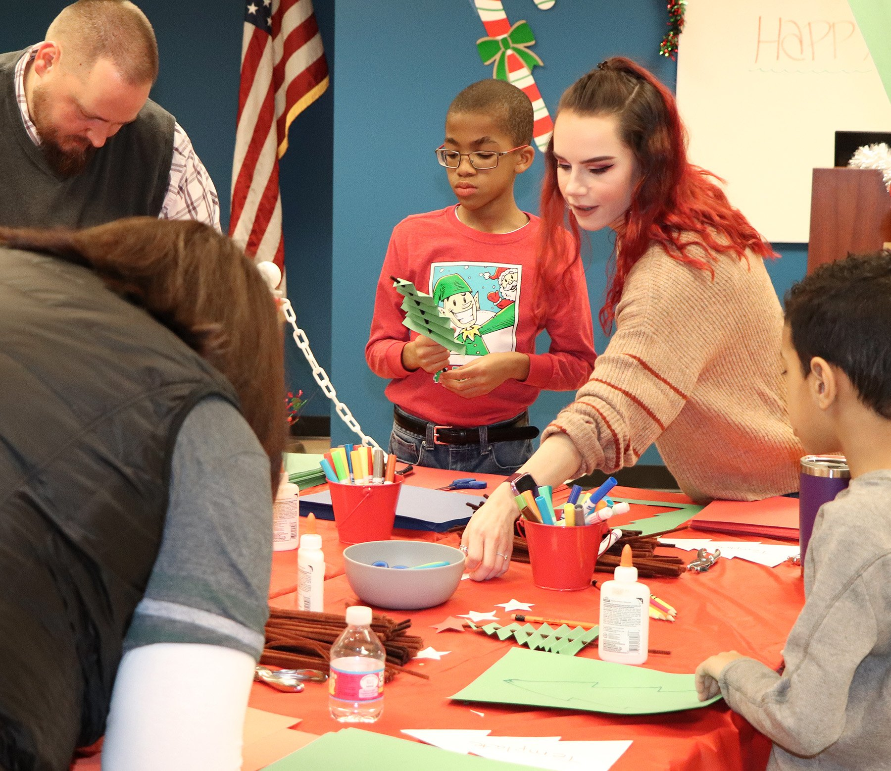 LAFCU's Larissa Moyer, second from right, helps with crafts at the credit union's Breakfast with Santa.