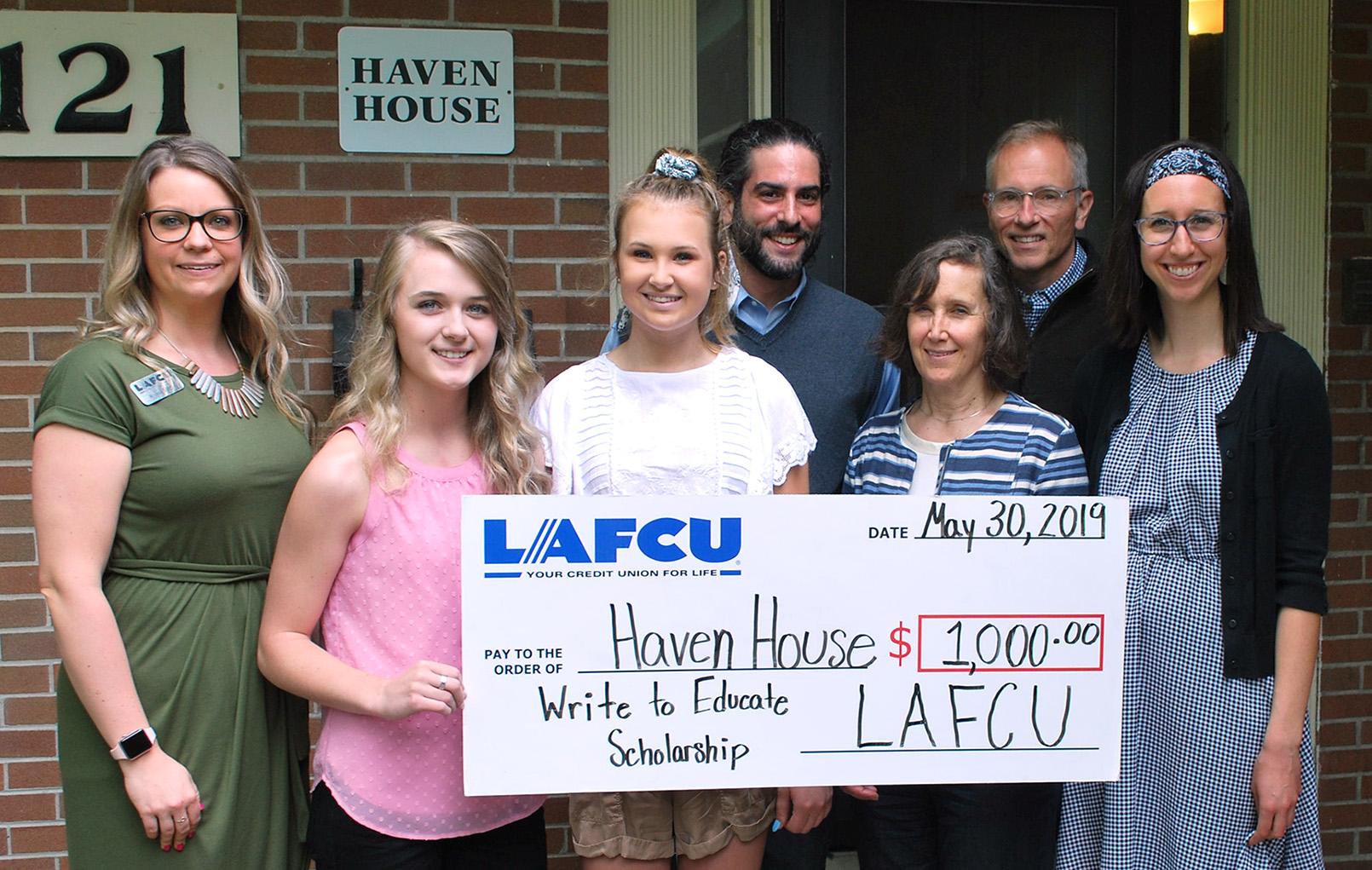 From left, LAFCU's Alyssa Sliger and winners of the 2019 Write to Educate Essay Contest, Julia Pate and Daisy Manzer, present LAFCU's charity donation to Haven House representatives: Gabriel Biber, executive director; Stacy Hickox , board president; Chris DeRose, board member; and Molly Cook, development director.