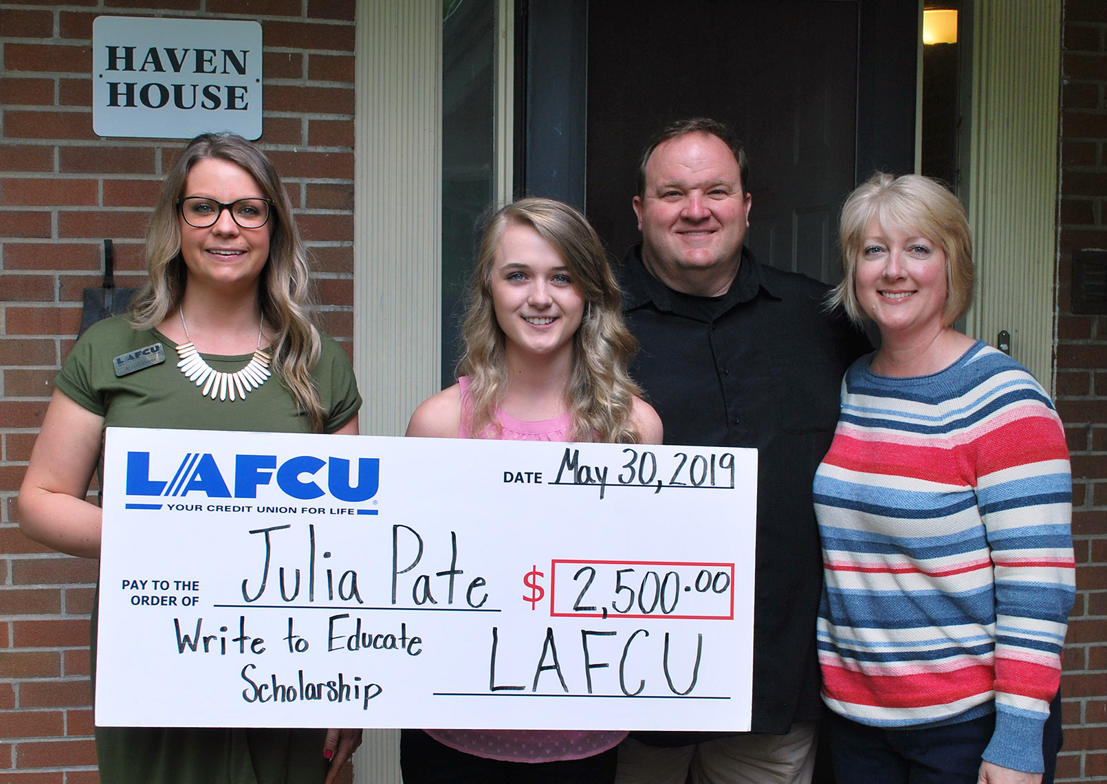 LAFCU's Alyssa Sliger presents a $2,500 scholarship to Baker College-bound Julia Pate. Also pictured are Pate's parents, Patrick and Kathy Pate of Lapeer.