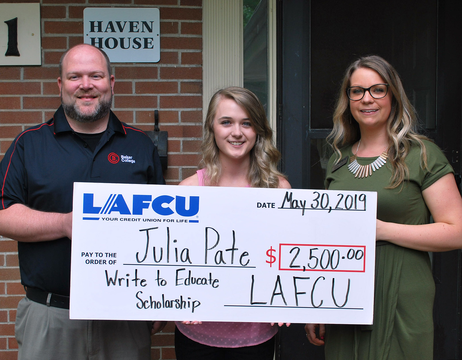 Baker College-bound Julia Pate, center, receives the LAFCU Write to Educate scholarship from LAFCU Marketing and Communications Specialist Alyssa Sliger, at right. Also pictured is Dave Knox, Baker College enrollment specialist.