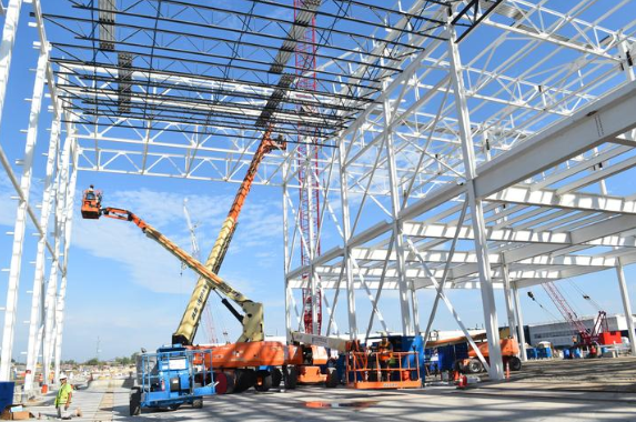 Steel is raised to form the structure of the paint shop being built to support FCA's new assembly plant on Detroit's east side.