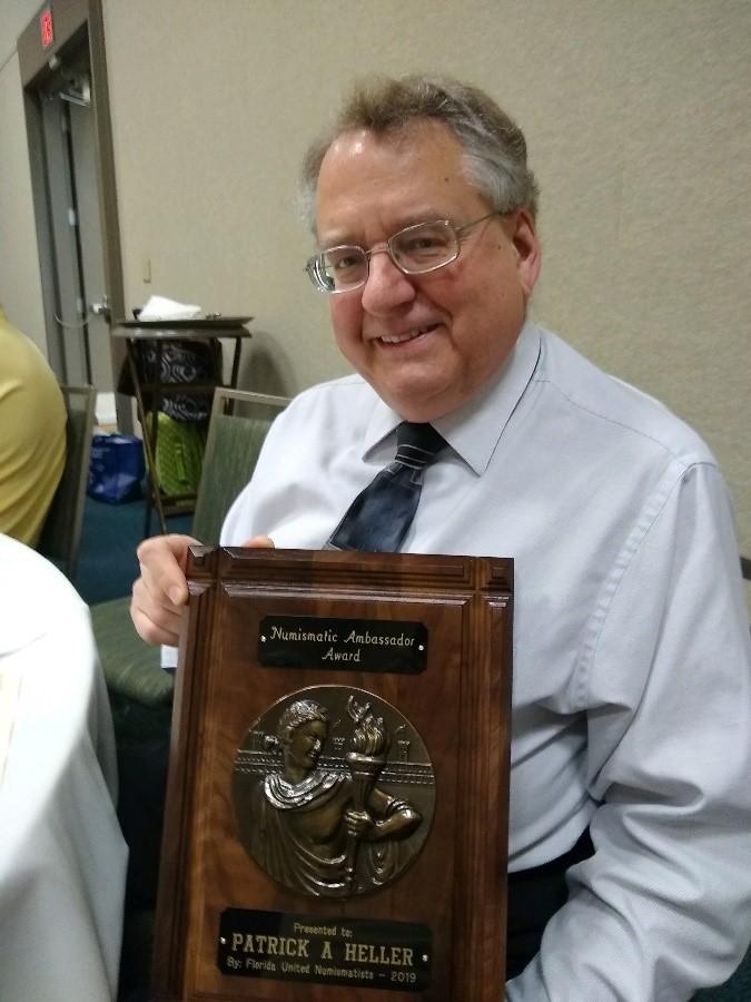 Patrick A. Heller with his Numismatic Ambassador Award